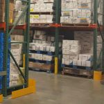 Post protectors on warehouse pallet racks