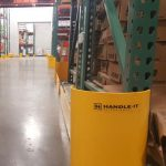 Closeup of Handle It rack protector inside Golden State Material Handling warehouse